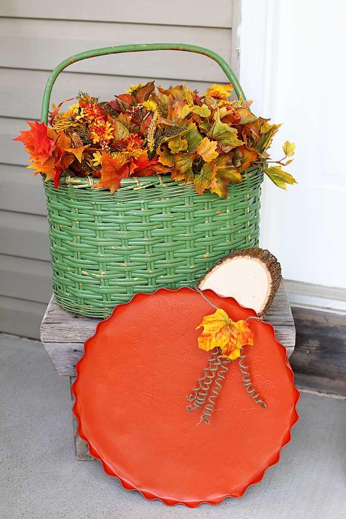 repurposing a serving tray into a pumpkin