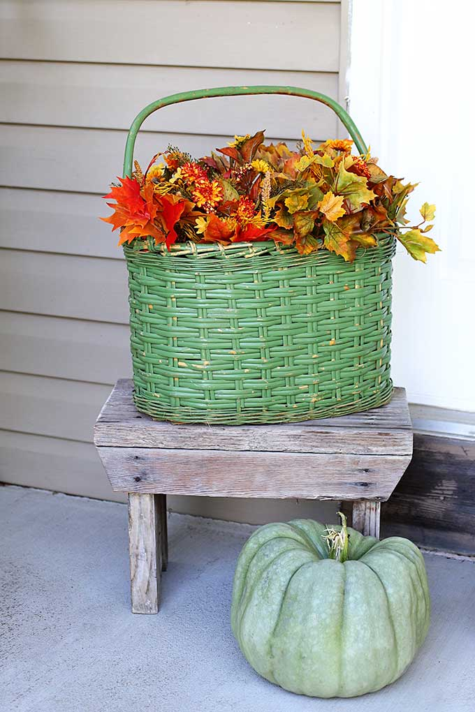 Vintage green basket with fall flowers