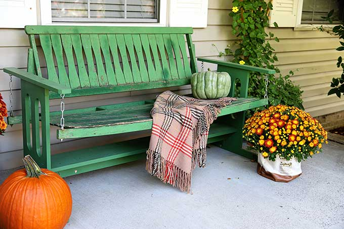 Vintage green porch glider
