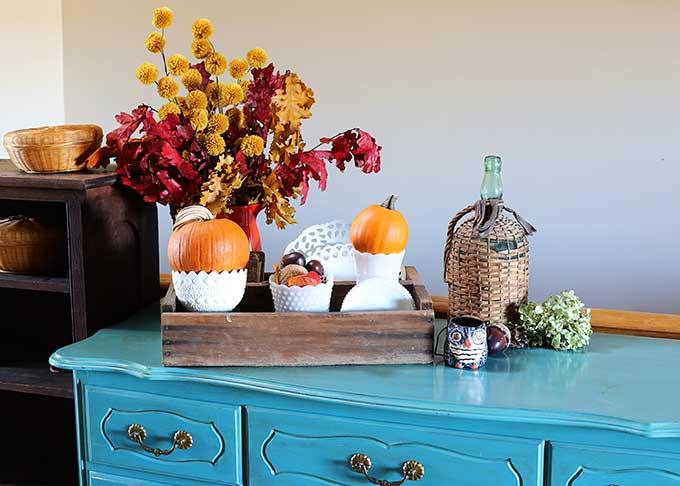 Vintage fall vignette using white milkglass