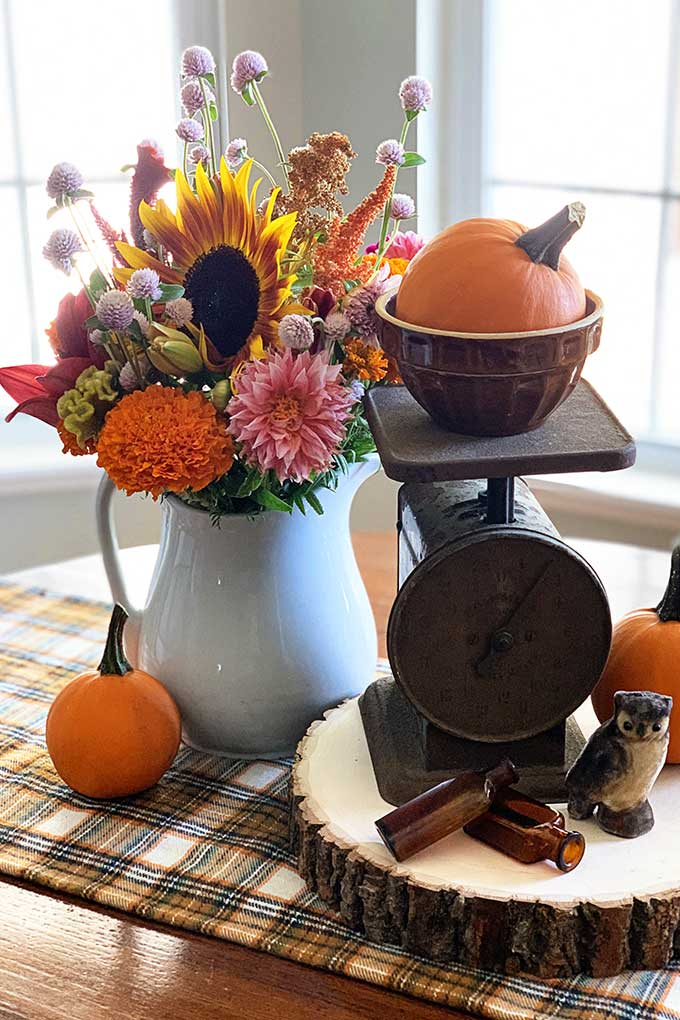 rustic table centerpiece using vintage scale and fall bouquet