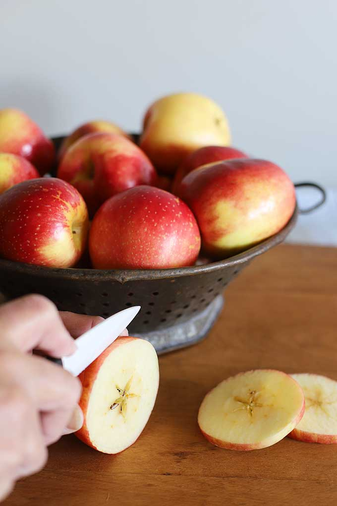 Slicing apples and oranges for homemade stovetop potpourri