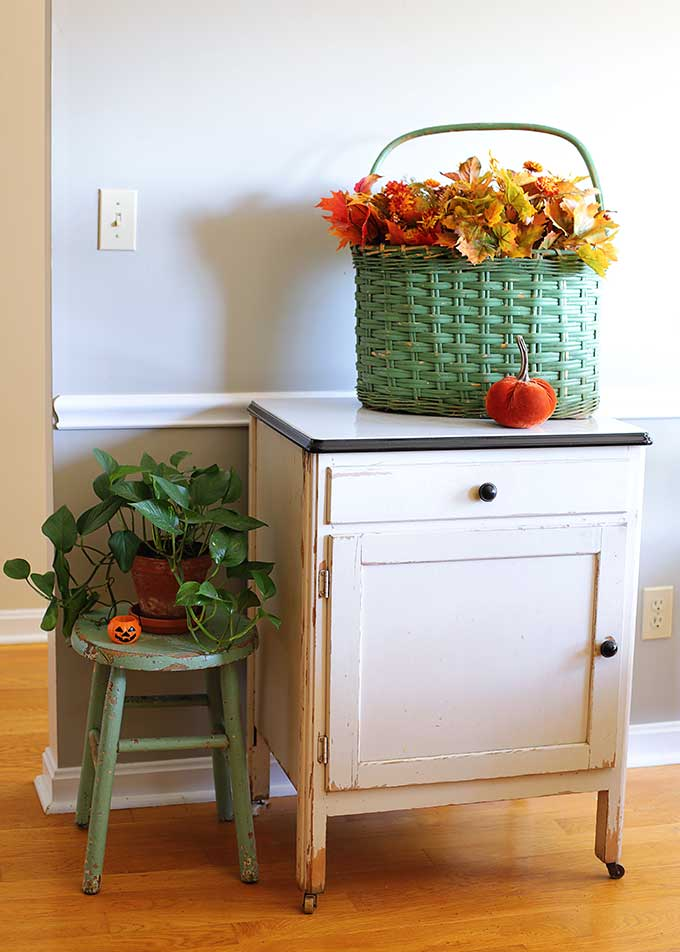 Vintage kitchen cabinet with fall decor