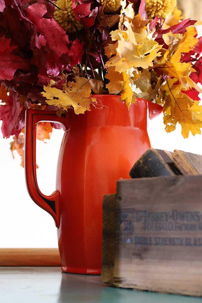 Vintage orange and black pitcher
