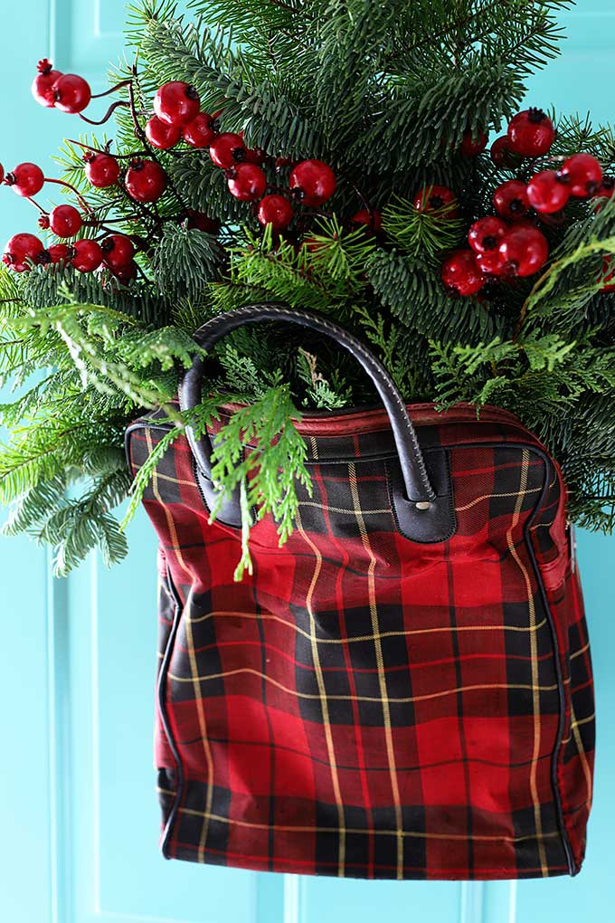 vintage plaid picnic tote used as a door wreath