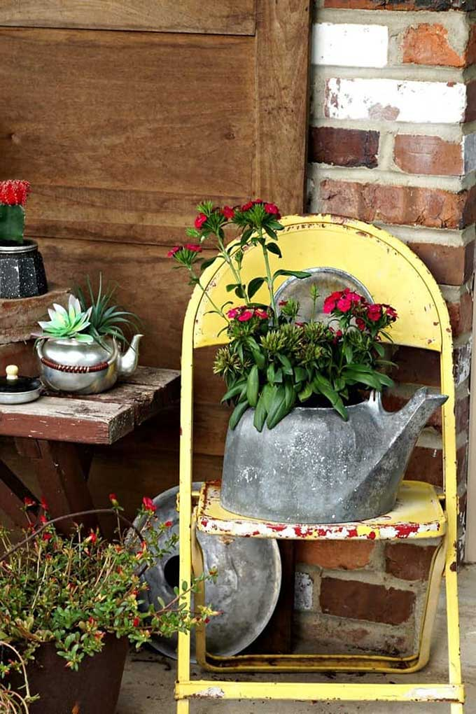 Upcycled tea kettle into a flower pot