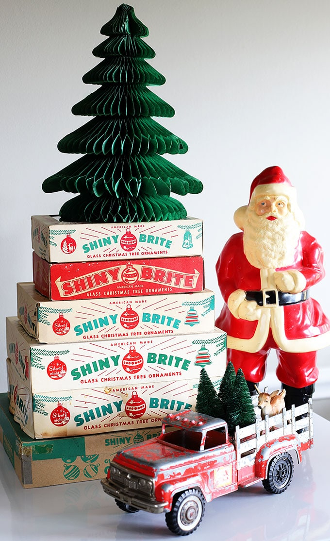 Shiny Brite boxes stacked for Christmas decor