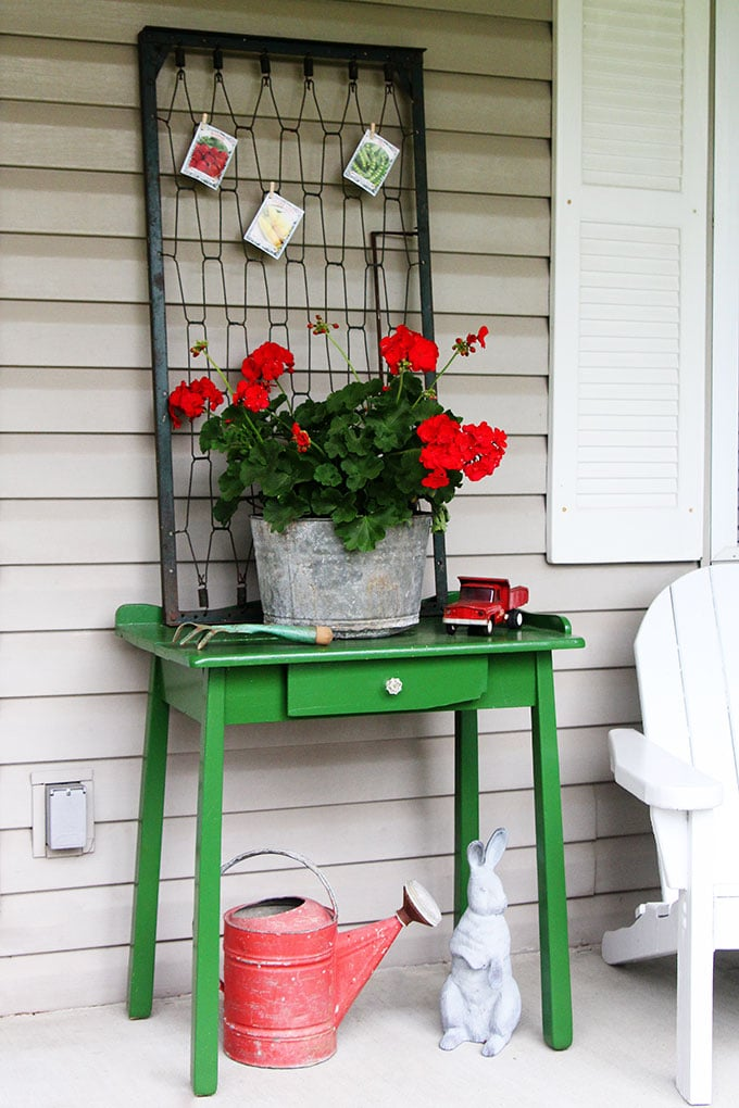Repurposed baby bed springs turned into spring porch decor