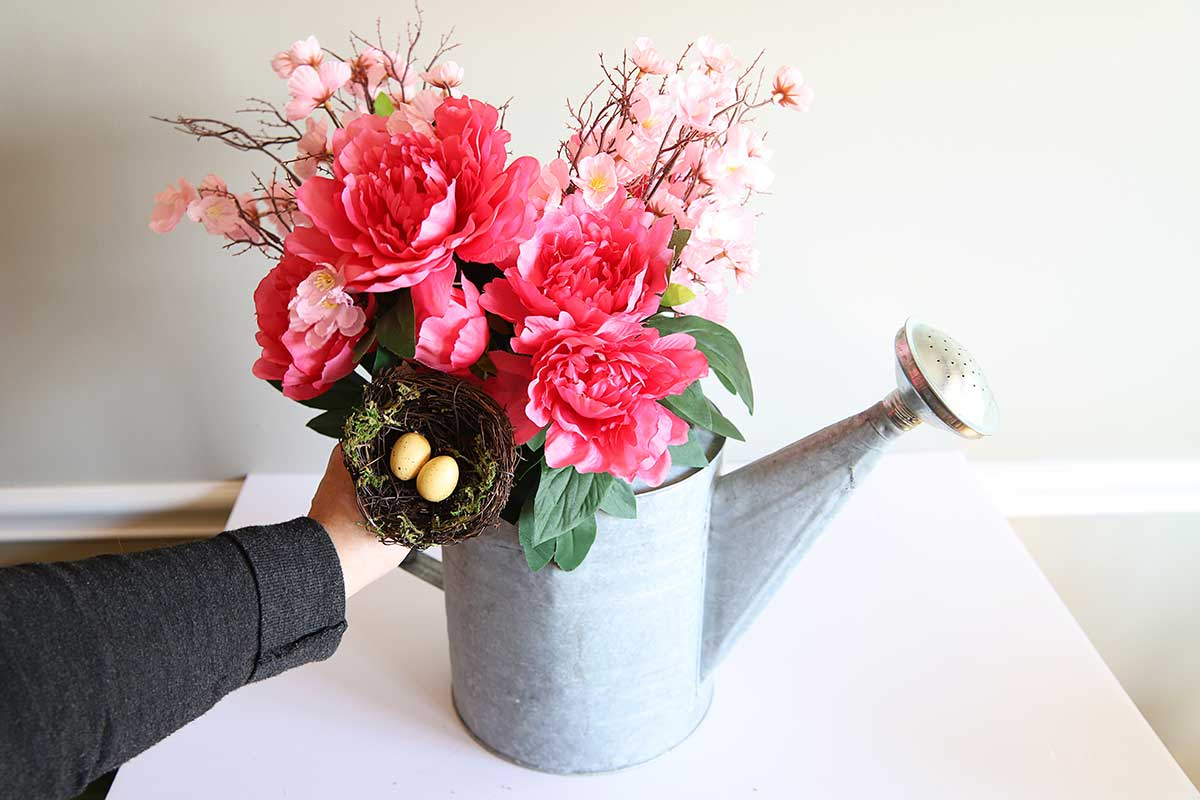 spring flower arrangement in watering can