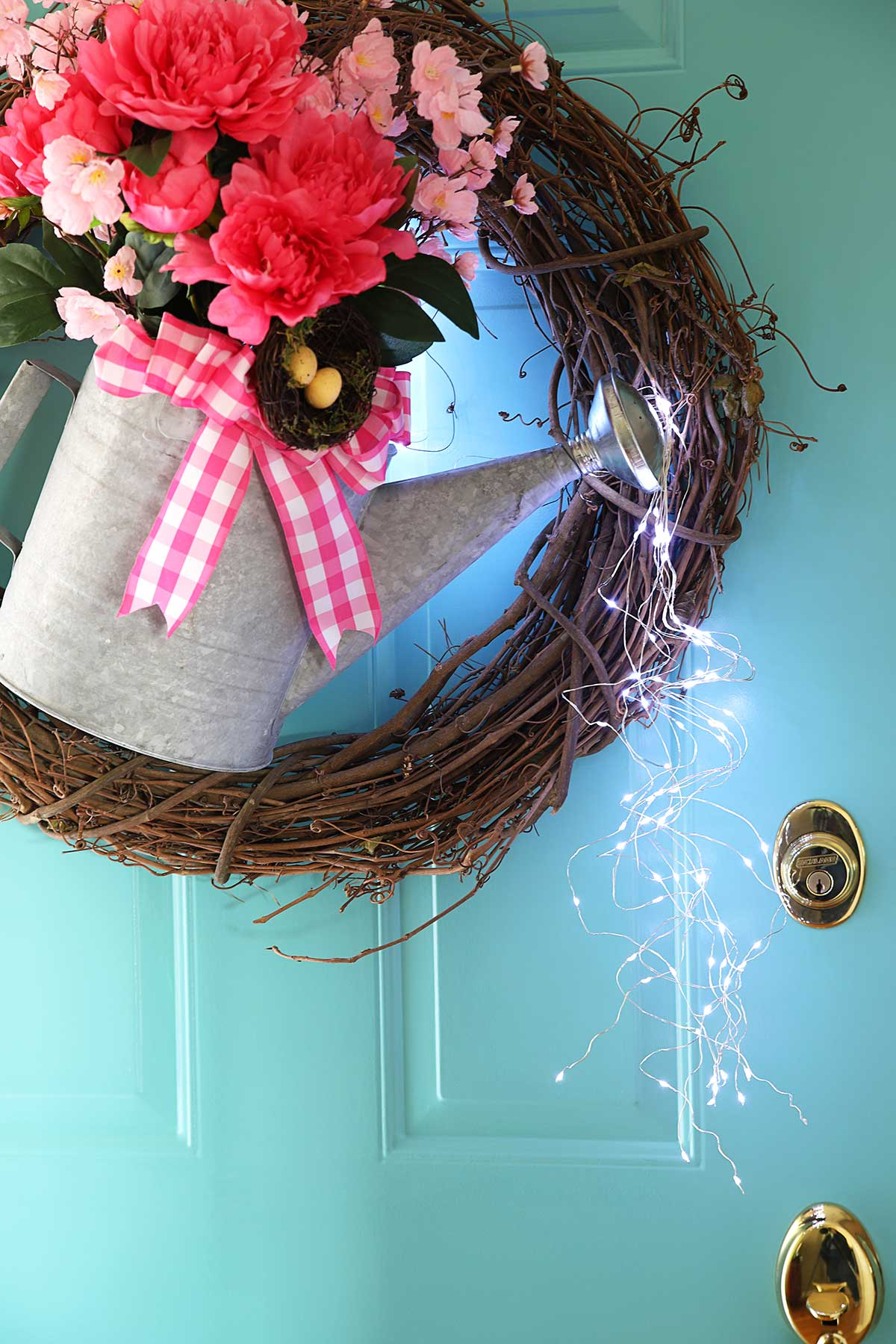 lighted watering can wreath