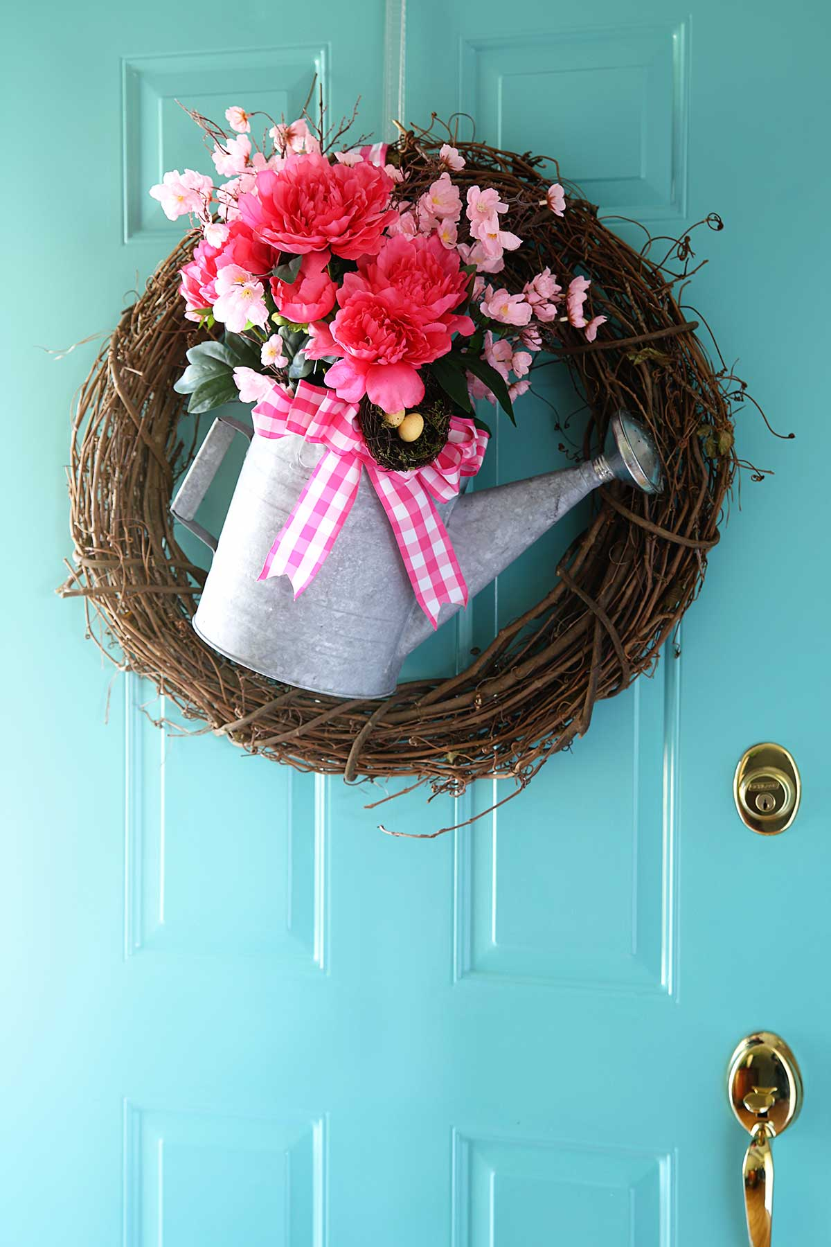 repurposed watering can spring wreath