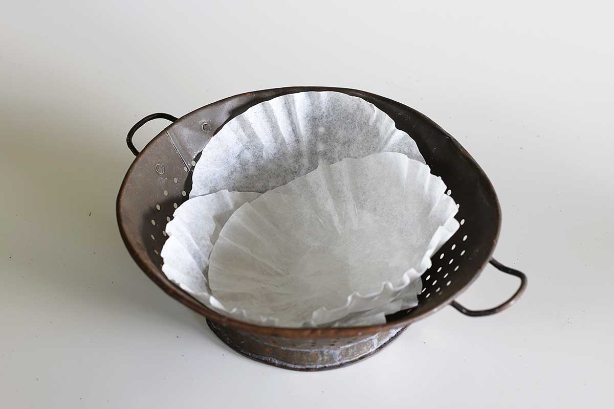 using coffee filters to line colander for planting