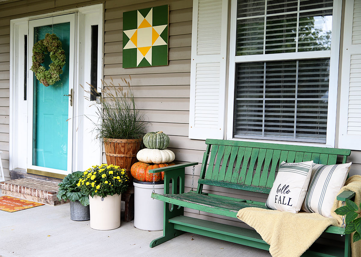fall porch decor in green and yellow