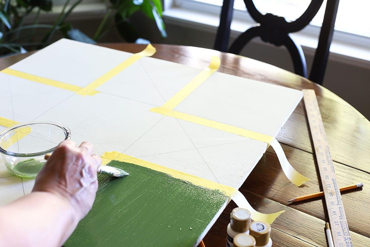 painting Ohio star barn quilt