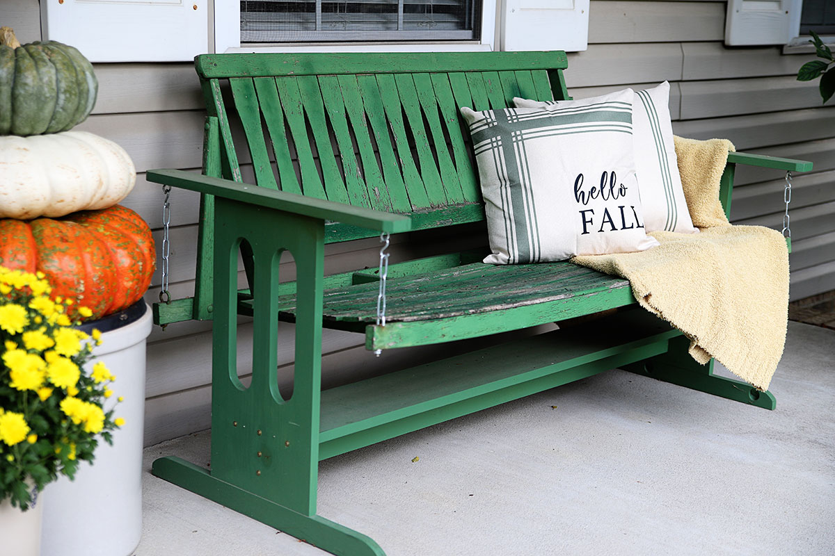 wooden green porch swing