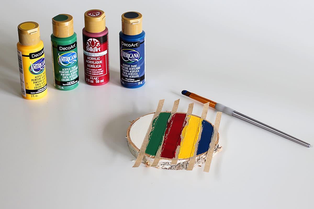 painting stripes on wood slice coasters
