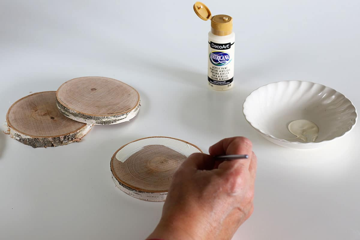painting wooden slices used as coasters