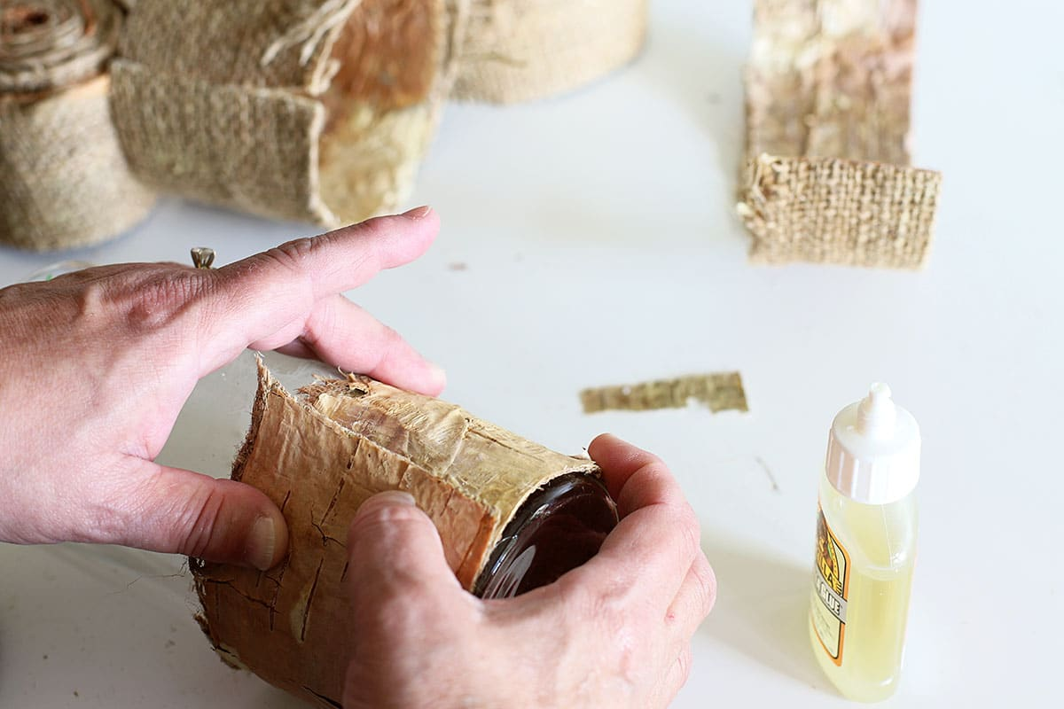 gluing birch bark to vases and candles