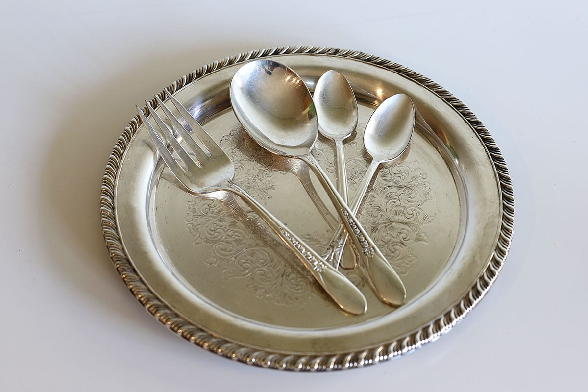 silverware after having been cleaned with the baking soda and aluminum foil method