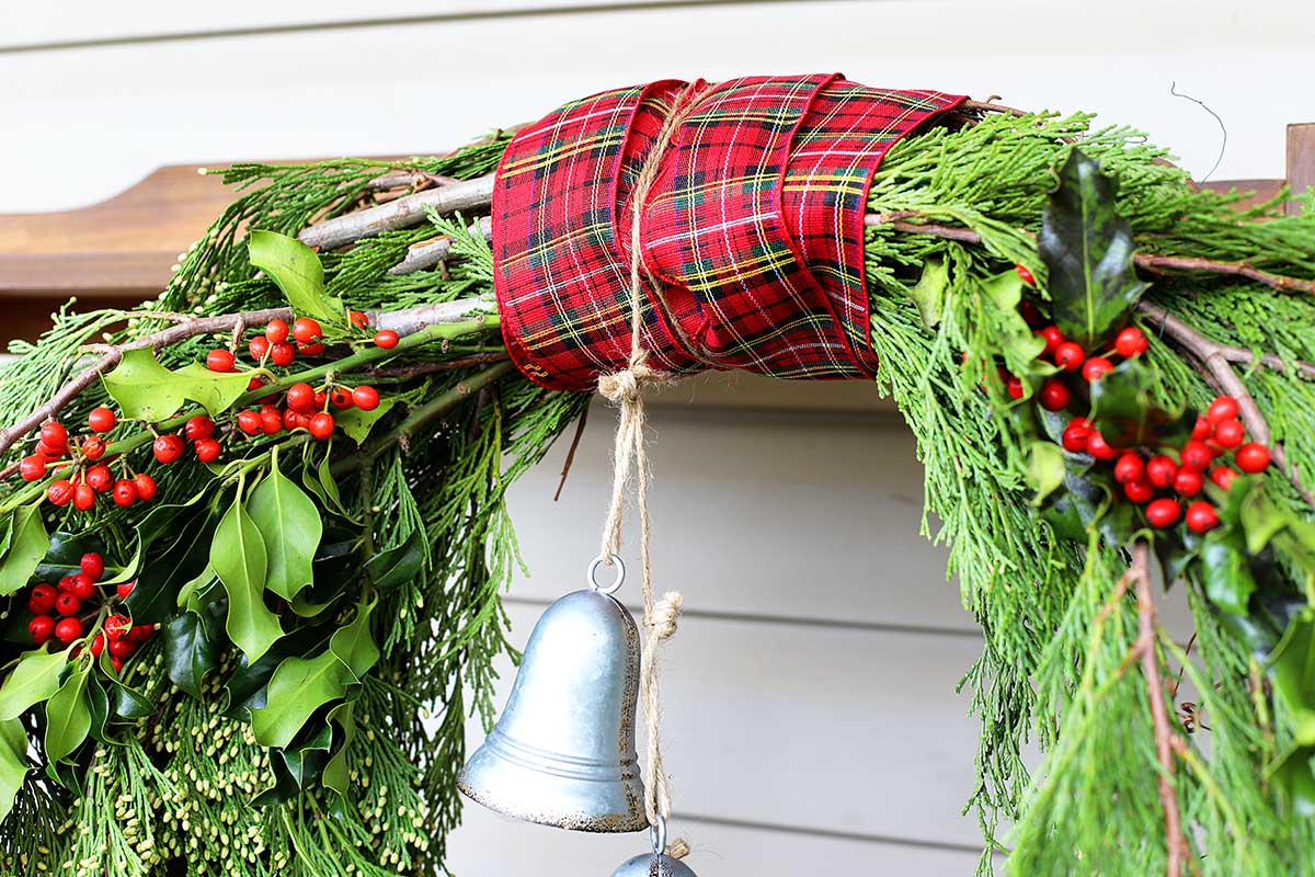 bell hung from evergreen wreath