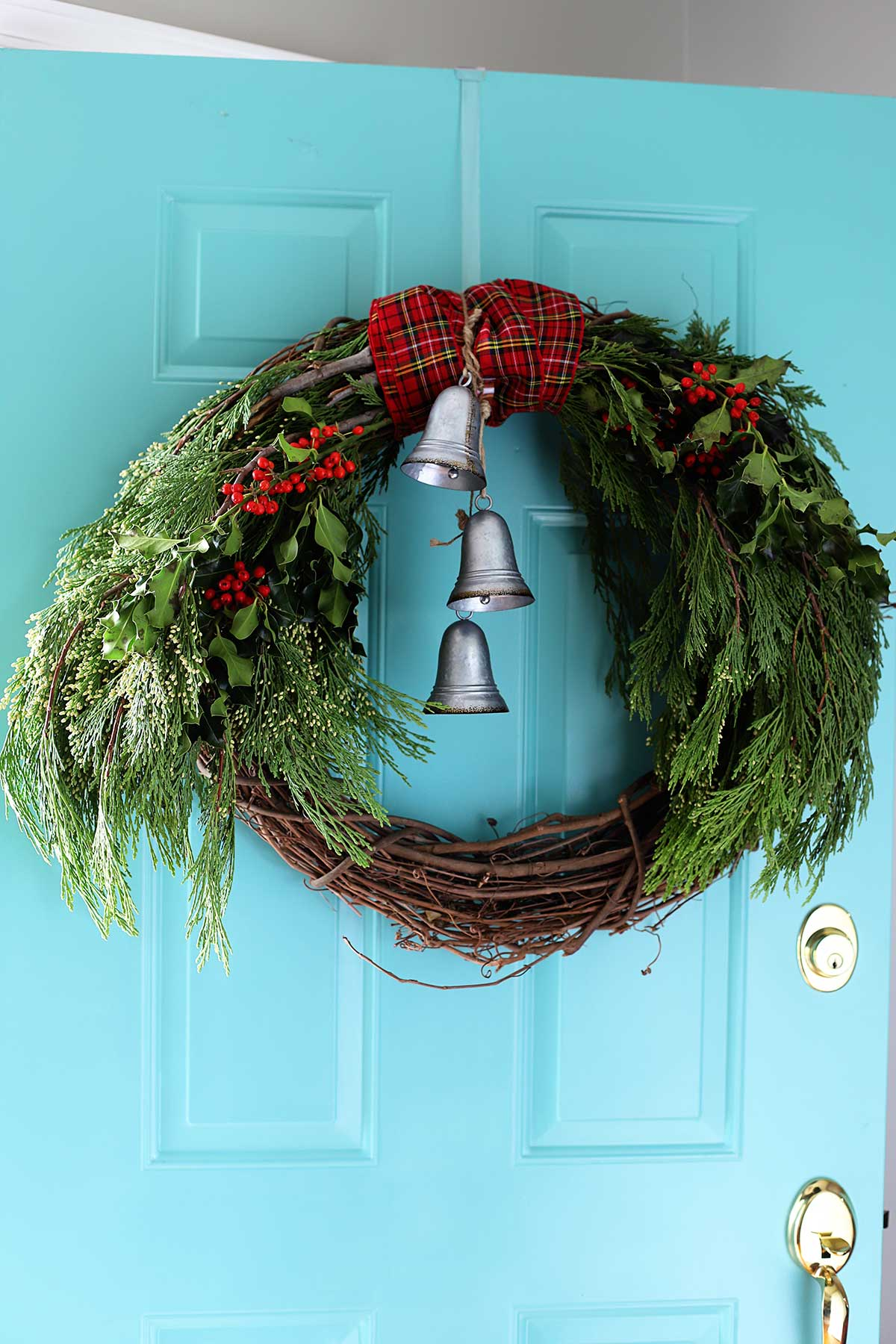 Easy to make winter wreath made with cedar boughs and holly