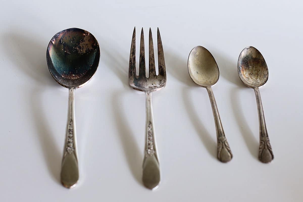 heavily tarnished silverware
