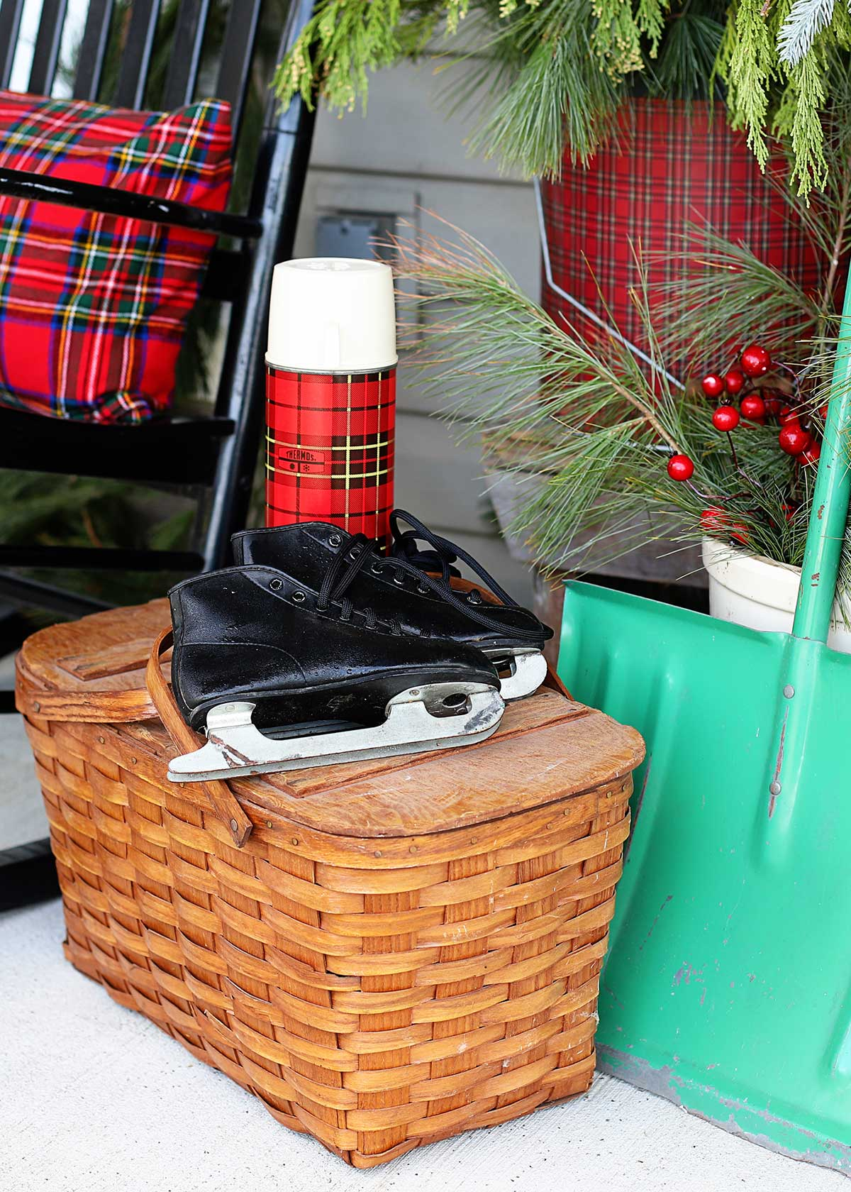 plaid on the porch used as Christmas decor