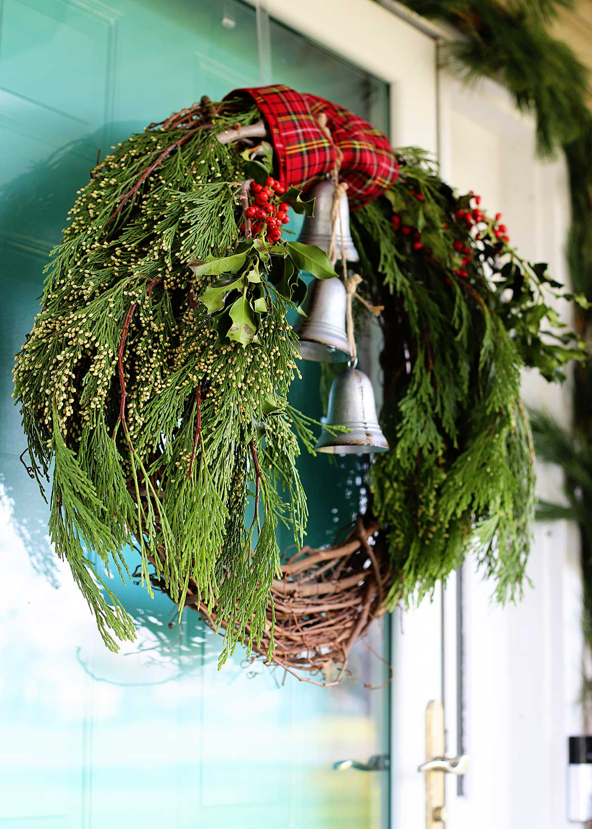 Christmas wreath made with fresh greenery and grapevine