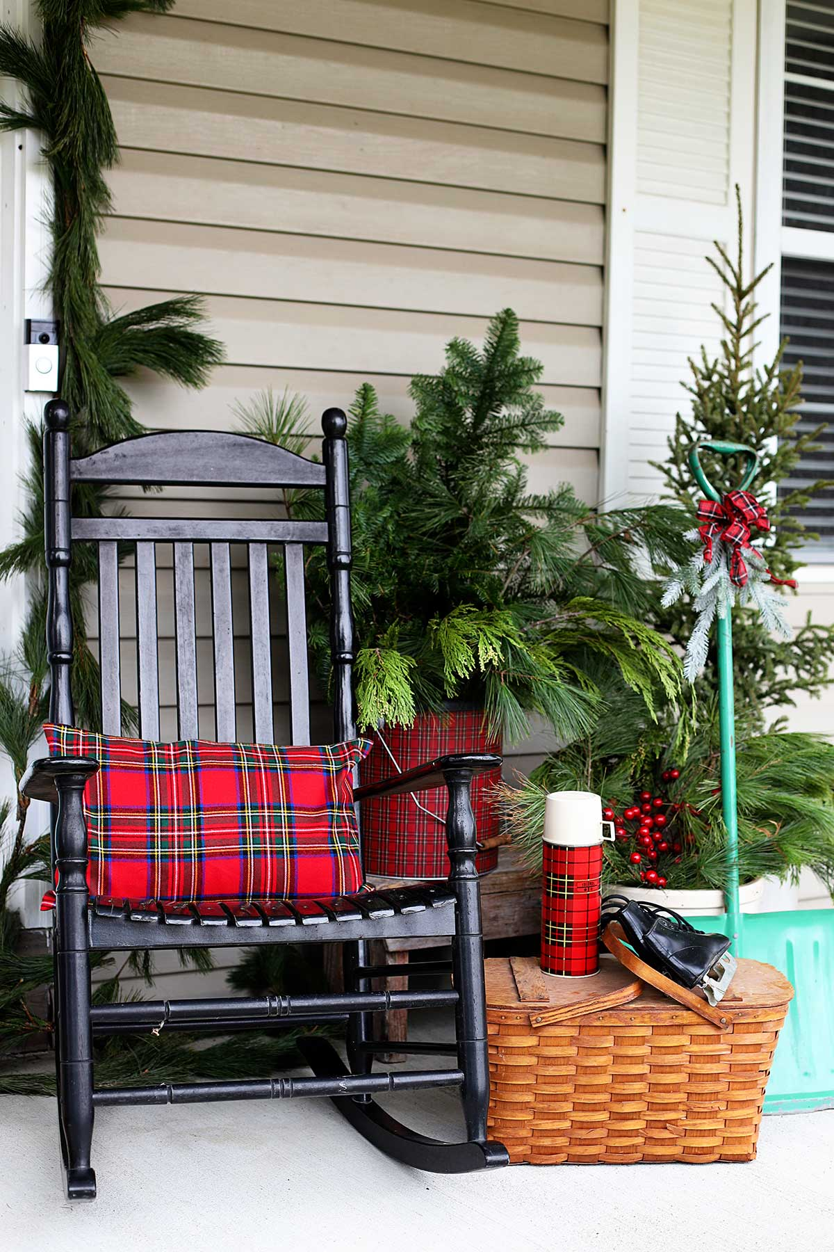 black porch rockers with plaid pillows for Christmas porch decor