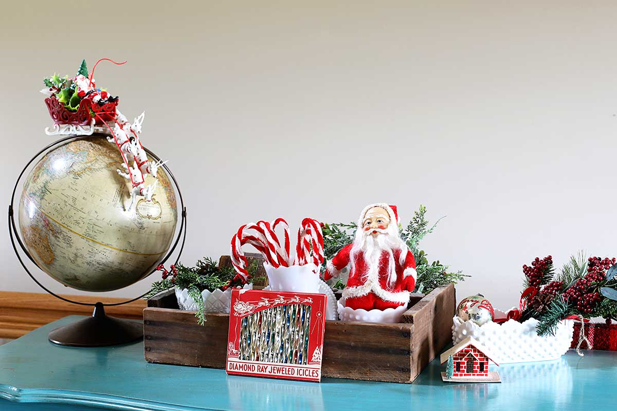 red Santas and candy canes mixed in with a collection of milk glass