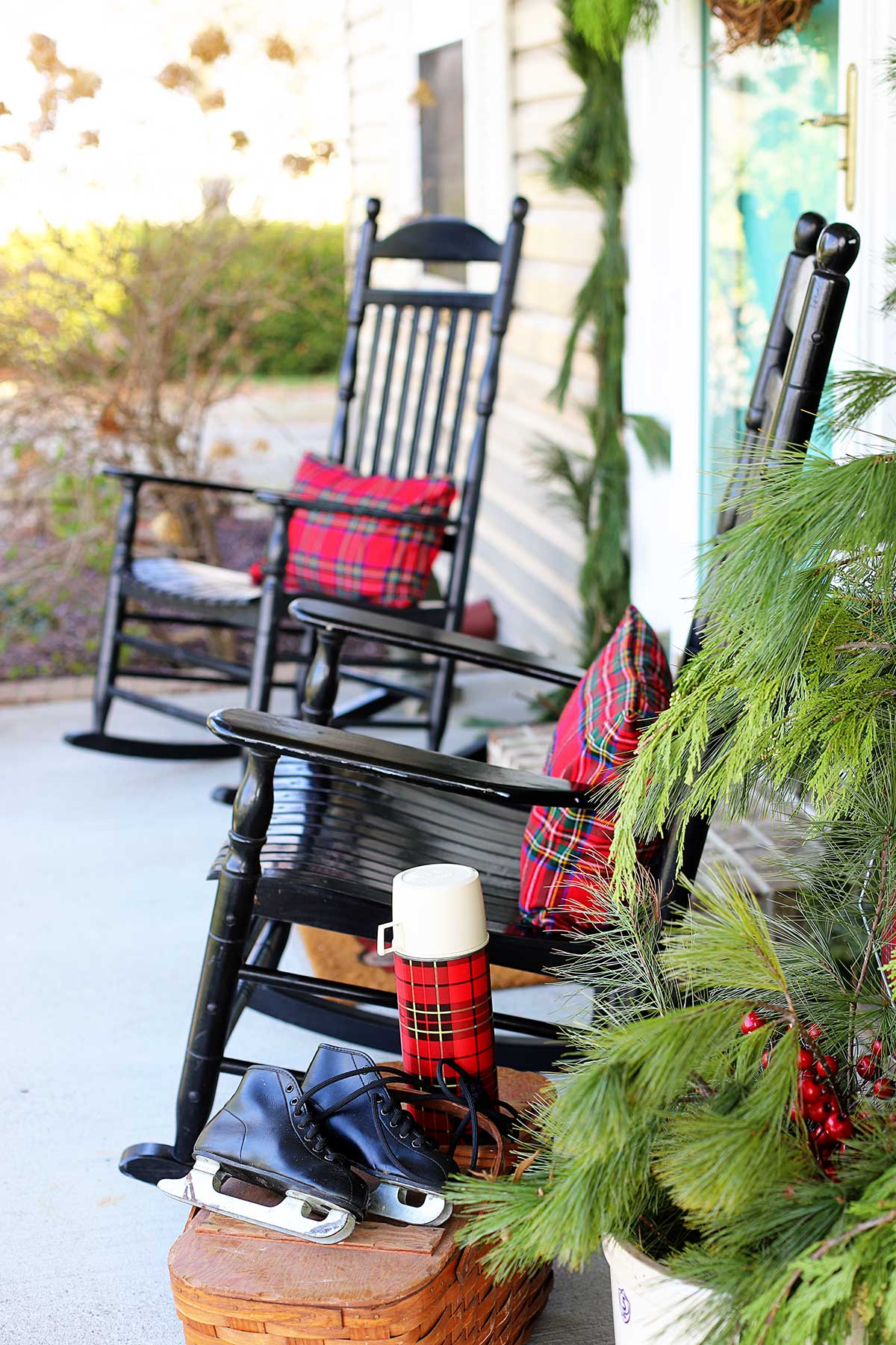 black rockers on the porch decorated for Christmas