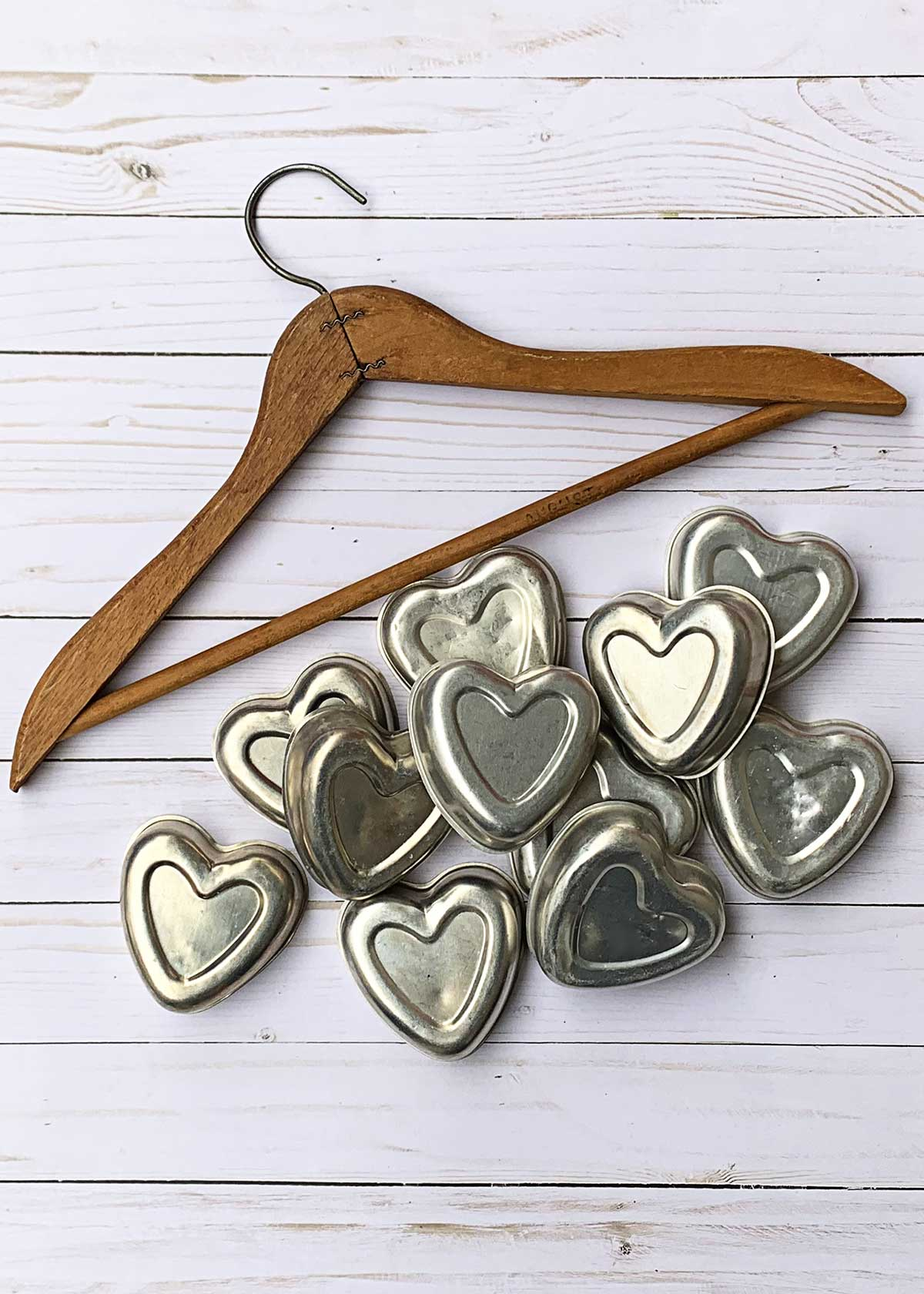 vintage tin heart shaped jello molds being used for a repurposed Valentines Day banner