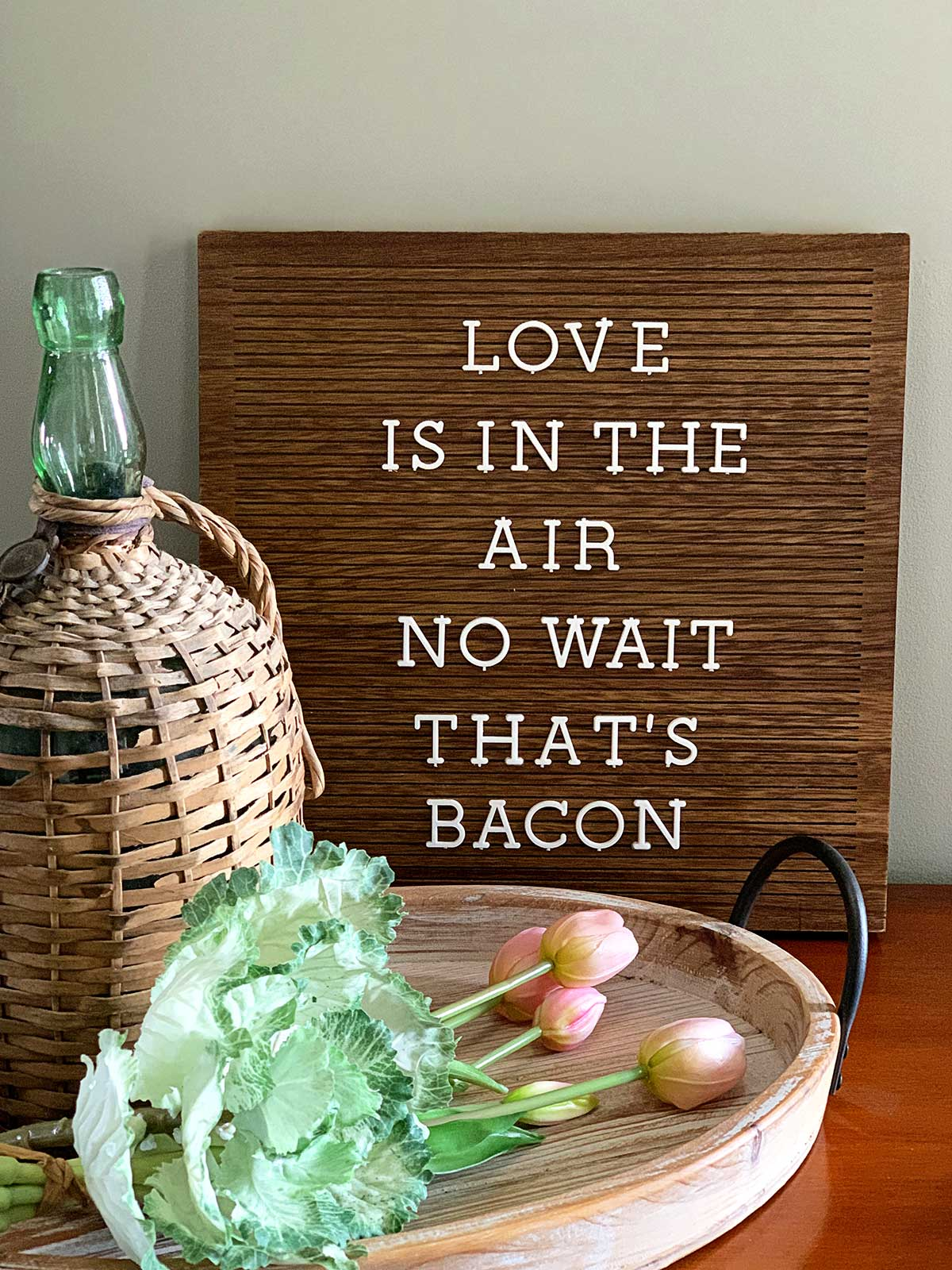 Letter board with the saying - Love is in the air, no wait that's bacon.