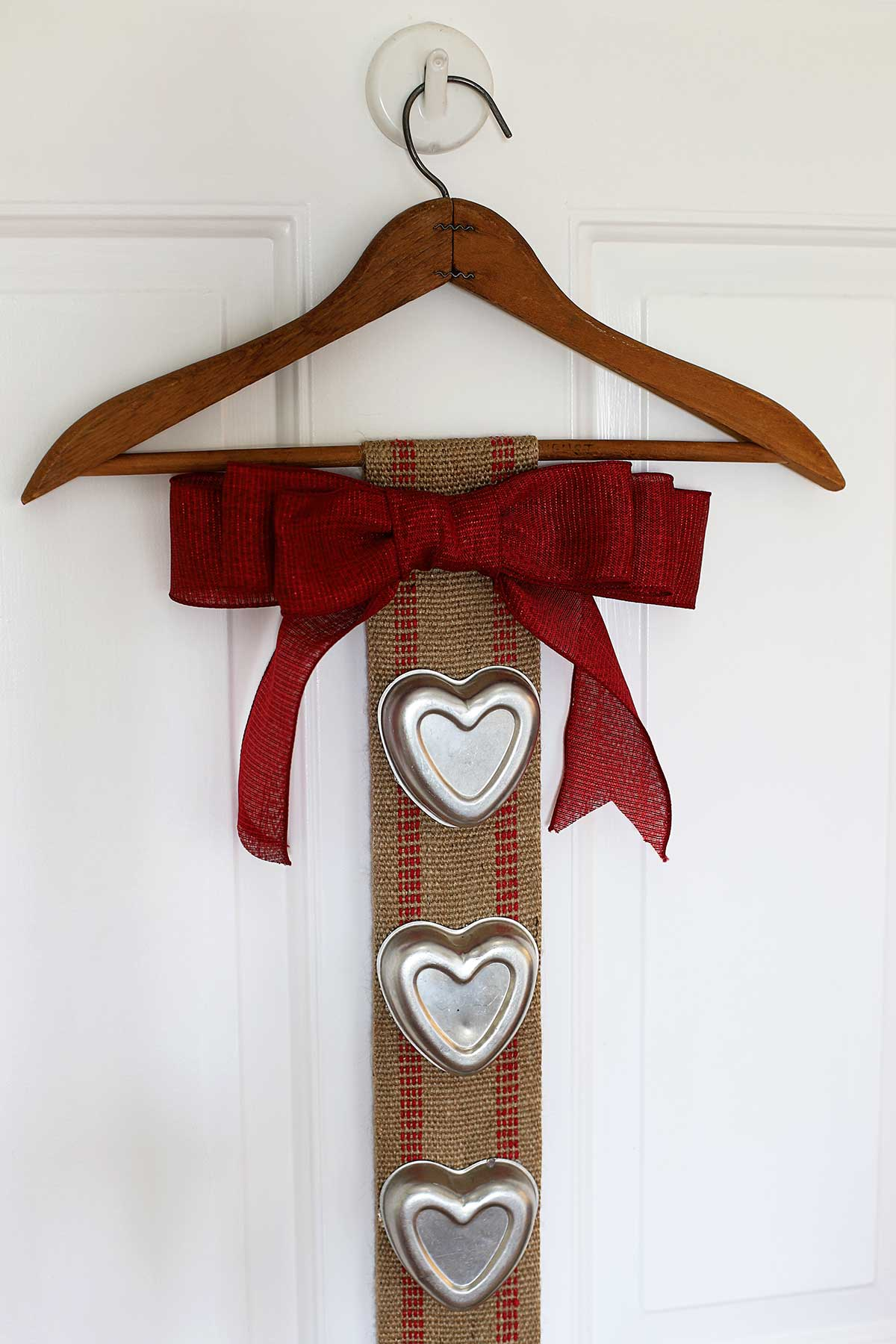 Upcycled Valentines Day banner using upholstery webbing and vintage tin heart jello molds