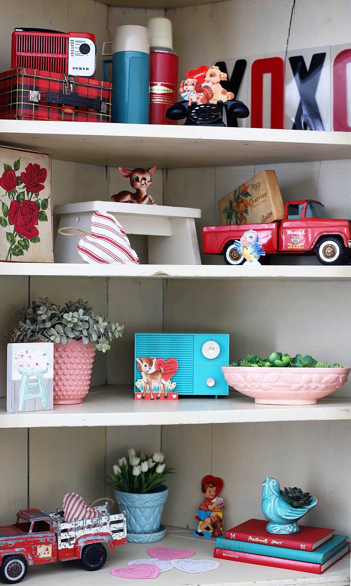 Vintage Valentines Day decor displayed in a bookshelf