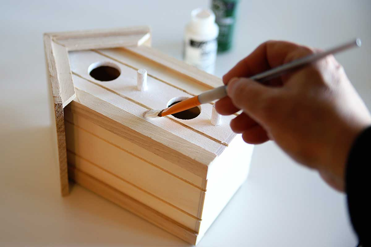 painting a craft store birdhouse