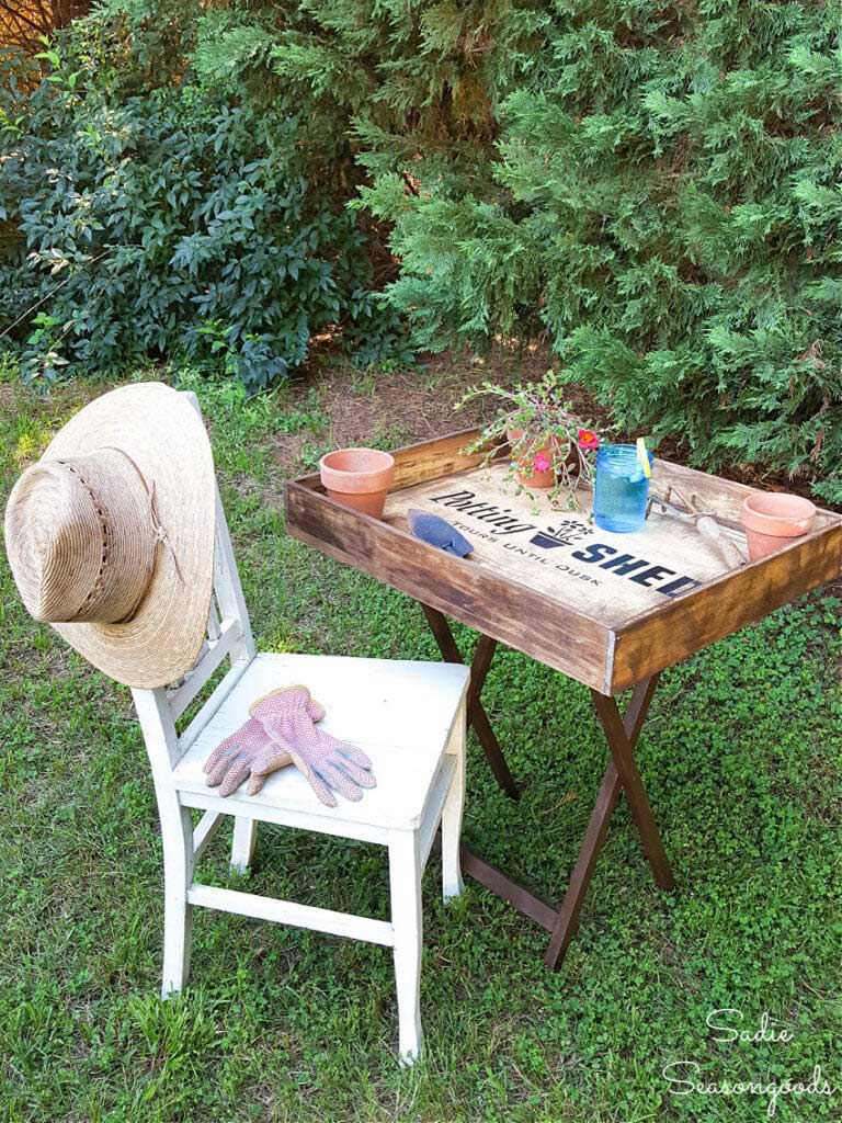 a portable potting bench set up in the yard