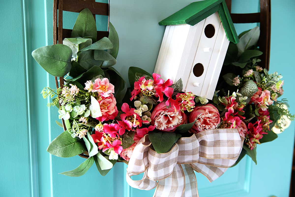 peony wreath for spring with birdhouse and eucalyptus leaves