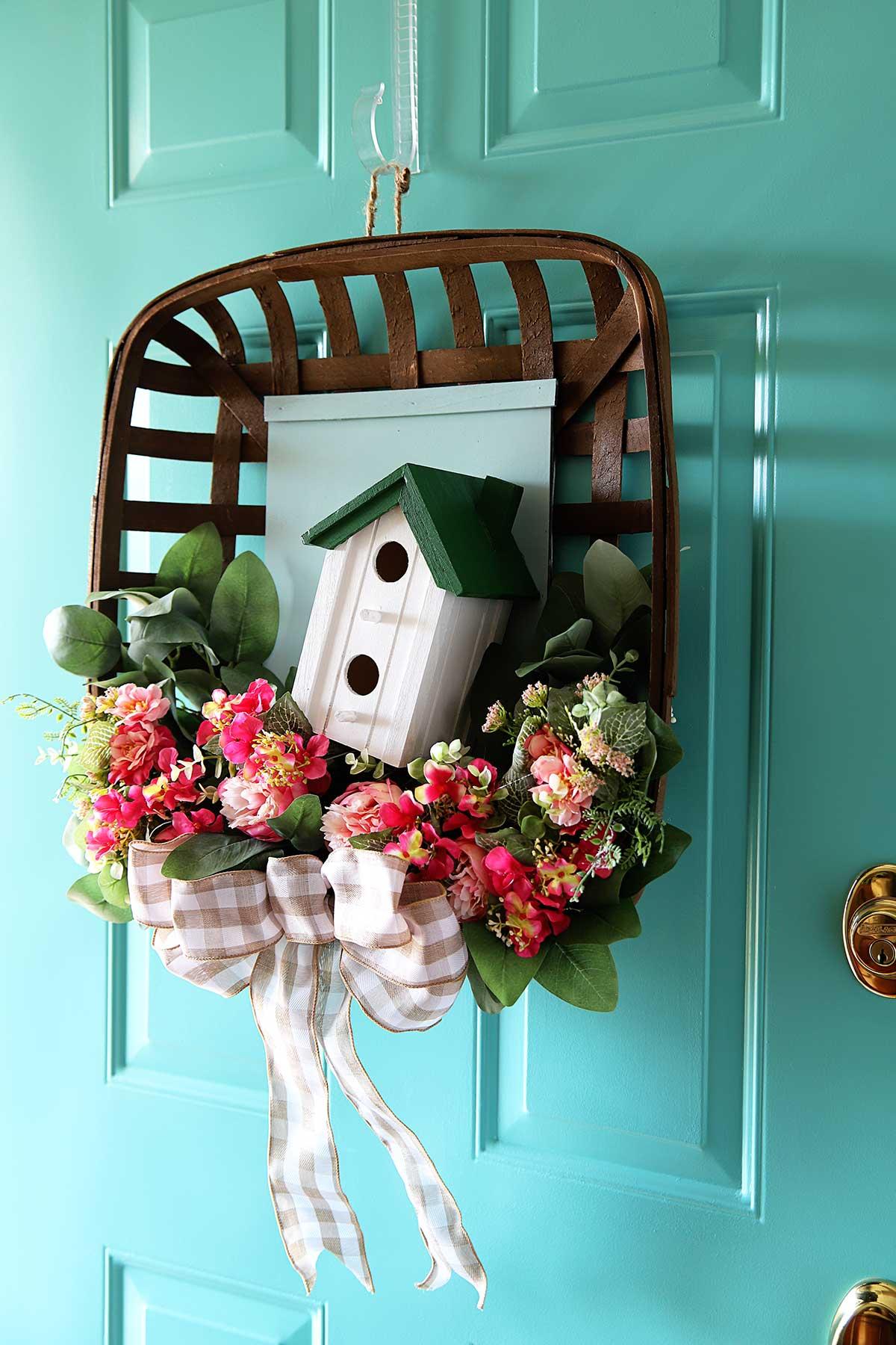 tobacco basket wreath hanging on the front door