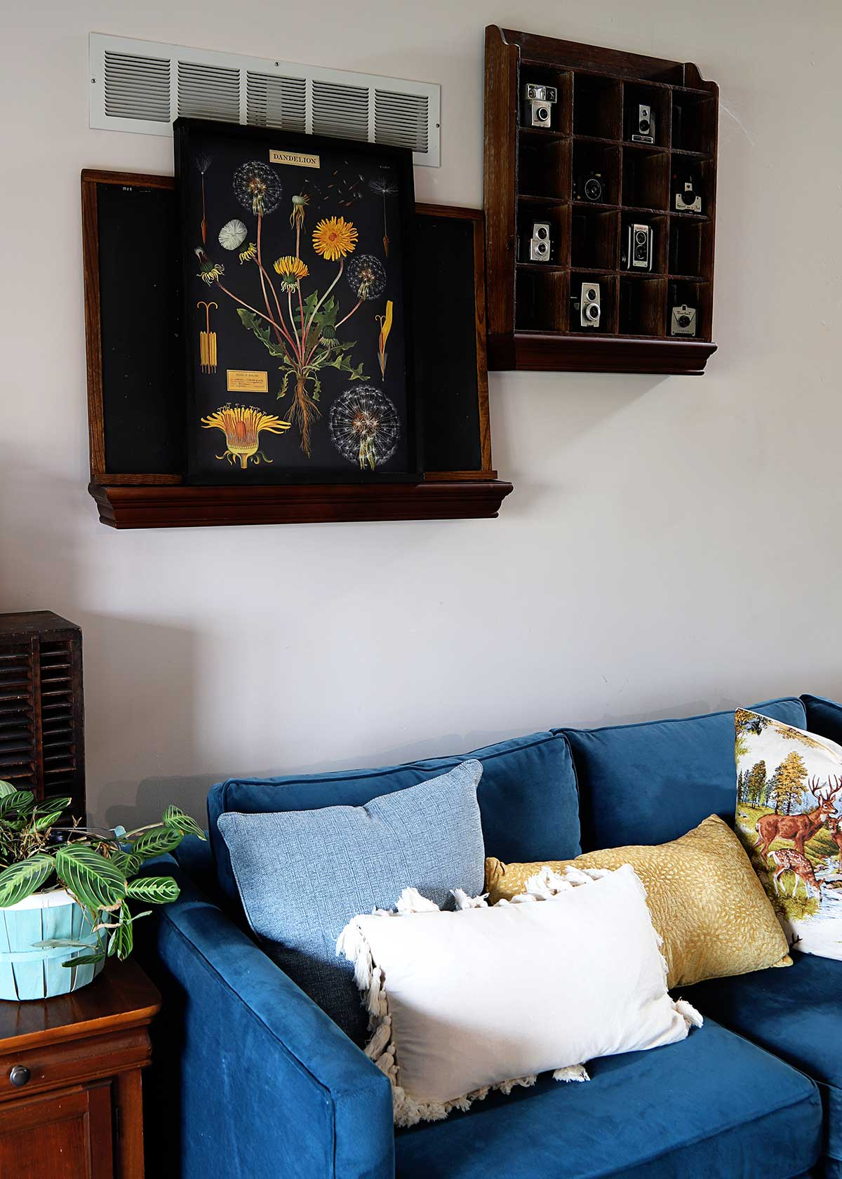 living room with bright blue sofa and artwork made from a poster and a DIY wood poster frame