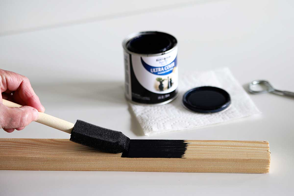 painting wooden frame with black paint