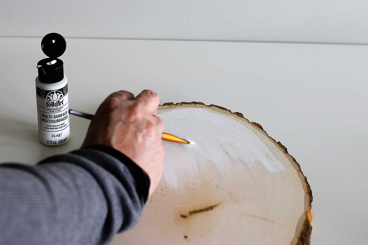painting wood slice white for crafting