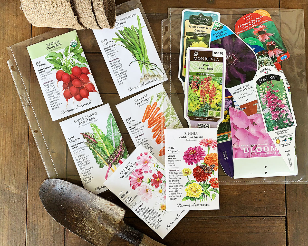 seed packets and plant tags in plastic sleeves for 3 ring binder - garden planner organization