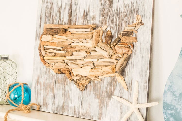 DIY driftwood flag on a white wooden background.