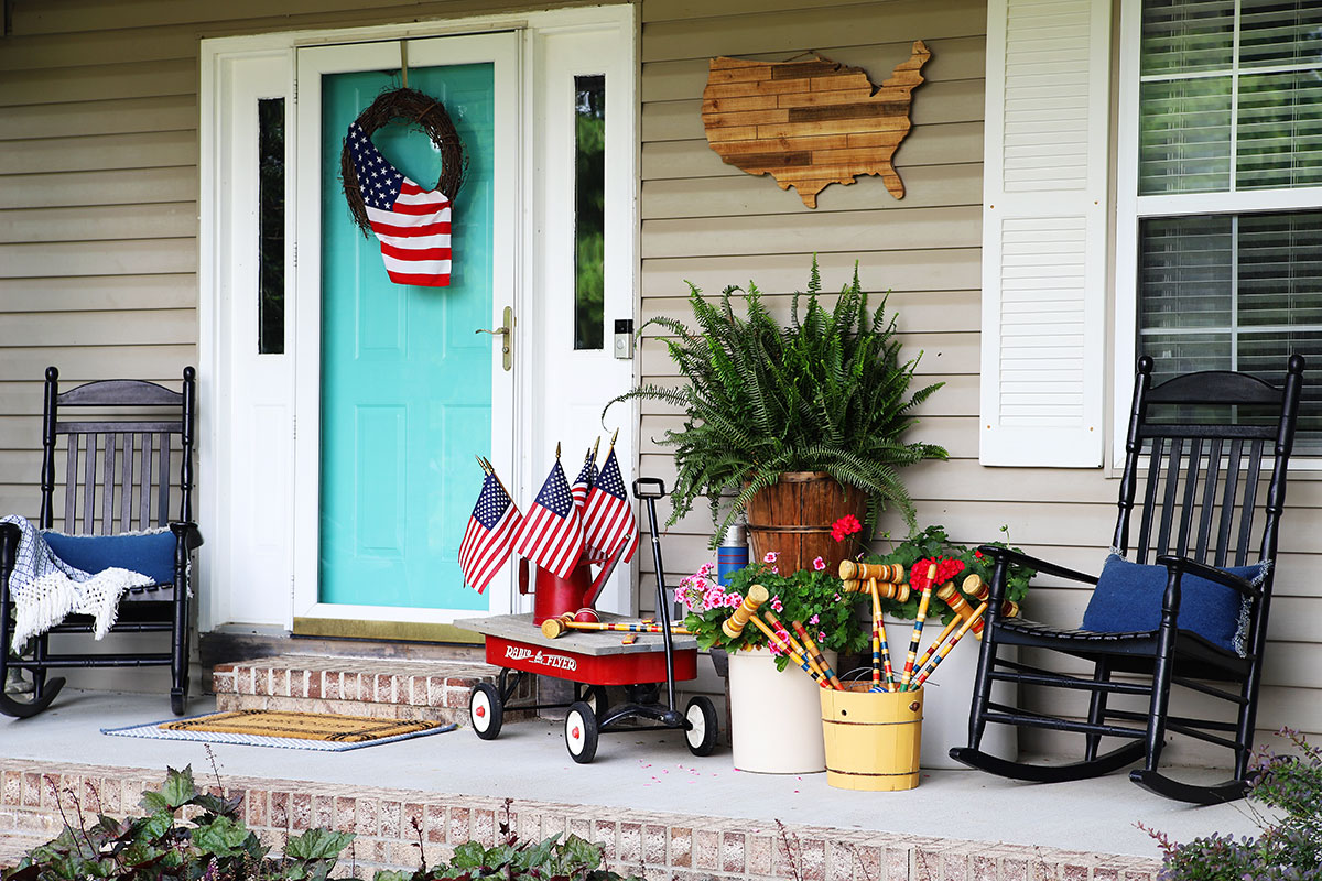Patriotic porch decor using thrift store finds and items commonly found in your garage or shed.