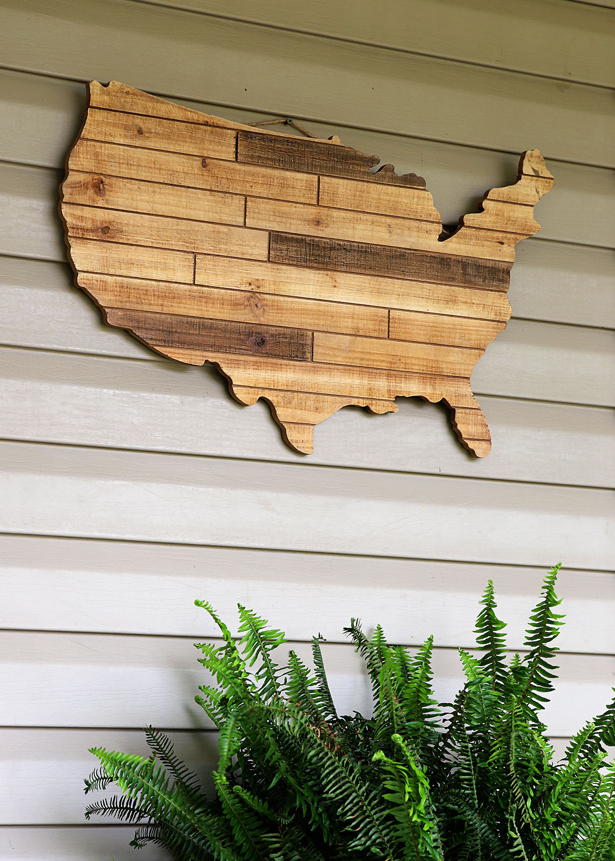 Wooden wall hanging in the shape of the United States.