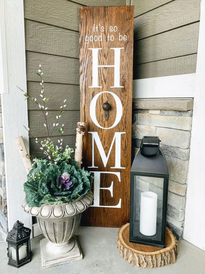 DIY porch leaner sign with the word HOME on it.