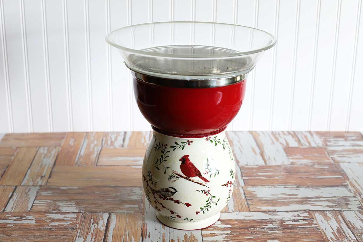 Thrift store kitchenware used to make a bird bath.