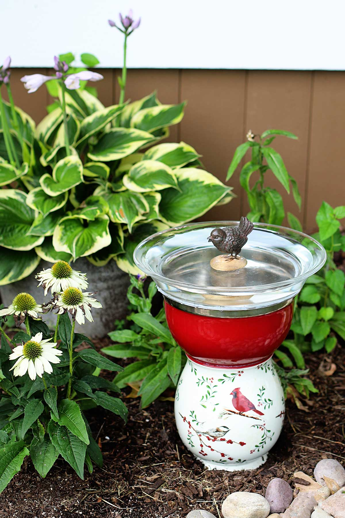 Upcycled thrift store glassware made into a bird bath for the garden.