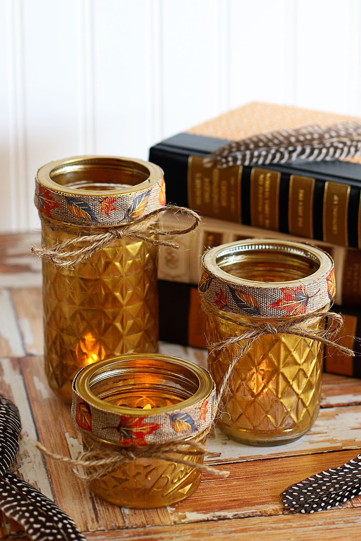Mason jars painted gold and used as candle holders.